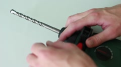 Man pulling out a drill from the perforator Stock Footage