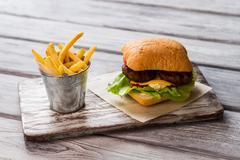 Bucket of fries and burger. Stock Photos
