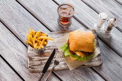 Hamburger and glass of cola. Stock Photos