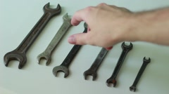 Worker choosing a wrench - stock footage