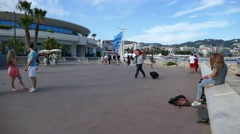 Alley Film festival center. France, Cannes,  People walking. - stock footage