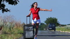 Slow motion. Hot summer and  beautiful sexy woman do hitchhiking - stock footage