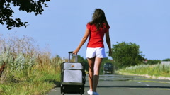 Slow motion. Sexy woman  slender legs and body with  suitcase on  road. Stock Footage