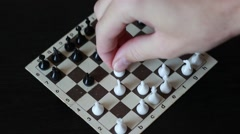 Man playing small chess Stock Footage