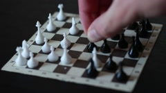 Chess player playing small chess Stock Footage