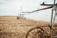 Mobile irrigation pivot watering a field Stock Photos