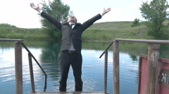 Businessman falls in water Stock Footage