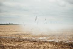 Mobile irrigation pivot watering a field - stock photo