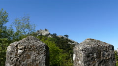 Tower behind rocks at Castle of the Moors Stock Footage