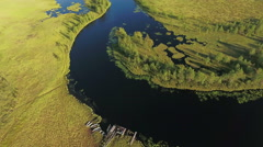 Watercourse river turn in the swampland of Karelia. Planked footway to the water - stock footage