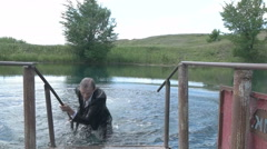 Businessman out of the water Stock Footage