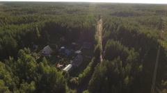 Evergreen wild forests with several wooden houses for living. Gravel road. North Stock Footage