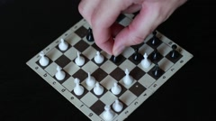 Chess player playing small road chess Stock Footage