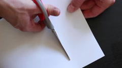 Cutting paper with scissors Stock Footage