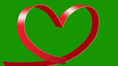 Red tape turns into a heart on a green background Stock Footage