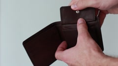 Student finding money in an empty purse Stock Footage