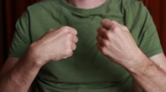 Man rotating his hands while gymnastic exercises Stock Footage