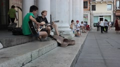 Street performers sitting on the steps of the Basilica Stock Footage