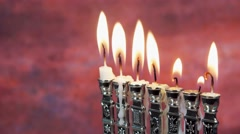 Jewish holiday Hanukkah creative background with menorah. View from above focus Stock Footage