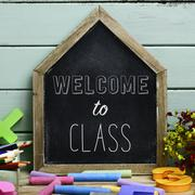 Text welcome to class in a house-shaped chalkboard Stock Photos
