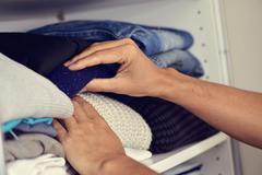 Young man arranging the closet Stock Photos