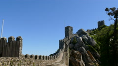 Tourists walking on wall at Castle of the Moors Stock Footage