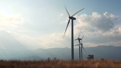 Mountain landscape and wind turbines Stock Footage