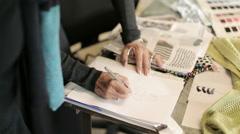 Clothing designer sketching - stock footage
