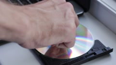Somebody inserts CD disk into the disk drive Stock Footage