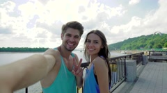 Athletic healthy cheerful couple in sportswear making selfie after training - stock footage