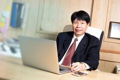 Business man asian manager senior age siting on desk look elegant Kuvituskuvat