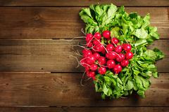 Fresh radish bunch on rustic wooden background Stock Photos