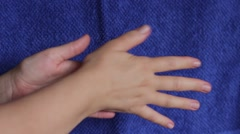 Woman fastly rubs her hands Stock Footage