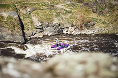 People rafting river rapids. Extreme tourism. Stock Photos