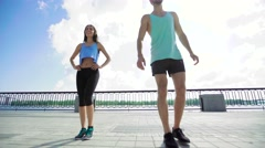 Full length of young couple exercising, personal trainer man coach and woman - stock footage