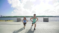 Sport, fitness, lifestyle and people concept - sporty woman and handsome man Stock Footage