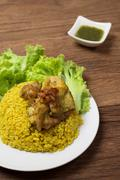 Thai chicken biryani or Yellow curry rice Thai Food Style on wood background Stock Photos