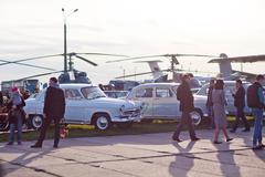 Kyiv, Ukraine - 23 APRIL, 2016: Many people, old cars and helicopters exhibit Stock Photos