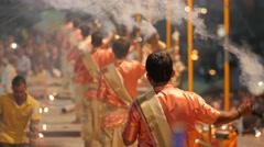 Priest at evening ceremony swinging inscence burner,Varanasi,India - stock footage