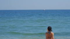 Girls on the Beach Go into Water and Sunbathing Together in Hot Summer Day Stock Footage