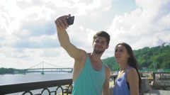 Good looking young couple taking a selfie with a smartphone before working out Stock Footage