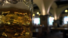 German Beer house, focus pull on close up of stein of beer Stock Footage