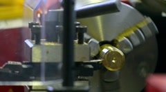 Lathe machine in action, super slow motion. Machining brass piece 250 fps close Stock Footage
