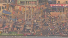Main ghat with pilgrims in early morning,Varanasi,India - stock footage