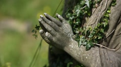 Praying hands - Angel on a cemetery Stock Footage