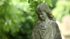 Sad Angel: statue on a cemetery Stock Footage