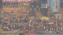 Main ghat with pilgrims in early morning with boats,Varanasi,India - stock footage