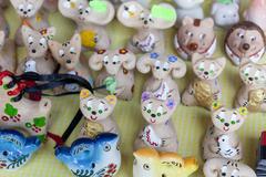 Many Ukrainian souvenirs clay figurines at the fair near Stock Photos