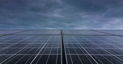 Timelaps of solar cell panel with dark sky to clear sky Stock Footage