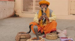 Indian snake charmer with turban n ghats,Varanasi,India Stock Footage